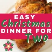"""roast chicken on a white plate with text overlay """"easy christmas dinner for two""""."""