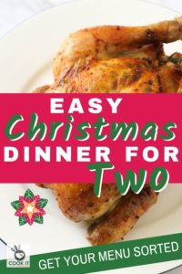 "roast chicken on a white plate with text overlay ""easy christmas dinner for two""."