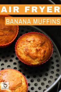 banana muffins in silicone muffin cases inside an air fryer basket.