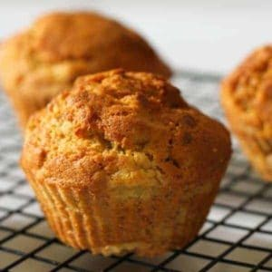 air fryer banana muffins on a wire cooling rack.