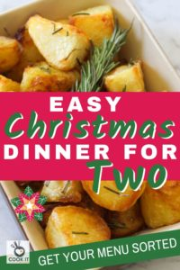 "roast potatoes in a dish with text overlay ""easy christmas dinner for two""."
