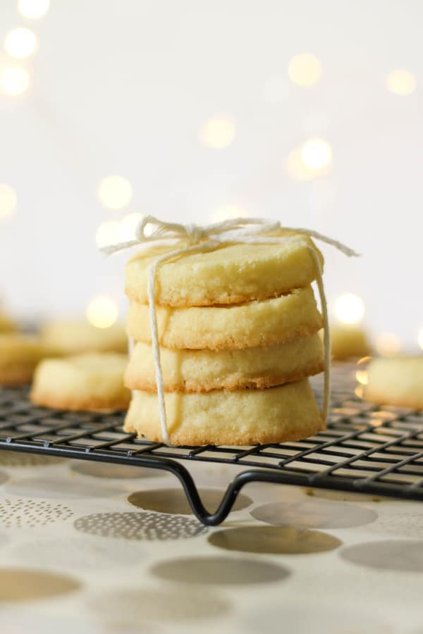 shortbread cookies stacked on top of a wire rack.