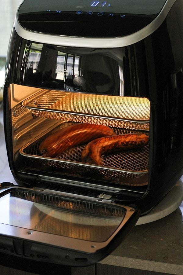 bananas roasting in an air fryer.