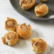 cinnamon pinwheels on a white marble background.