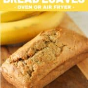 "mini loaf of banana bread on a wooden board with text overlay ""mini banana bread loaves""."
