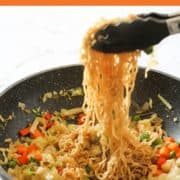 vegetable stir fry with noodles in a wok.