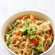 vegetable stir fry with noodles in a white bowl.