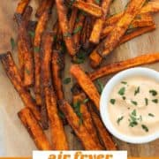 "fries on a wooden serving board with text overlay ""air fryer carrot fries""."
