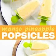 mango pineapple popsicles on a white plate covered in ice cubes.
