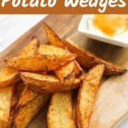 """potato wedges on a wooden board with text overlay """"air fryer potato wedges""""."""