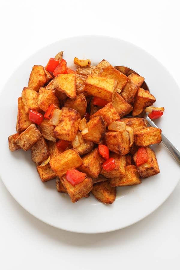 breakfast potatoes on a white plate.