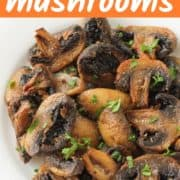 """mushrooms on a white plate with text overlay """"air fryer mushrooms""""."""