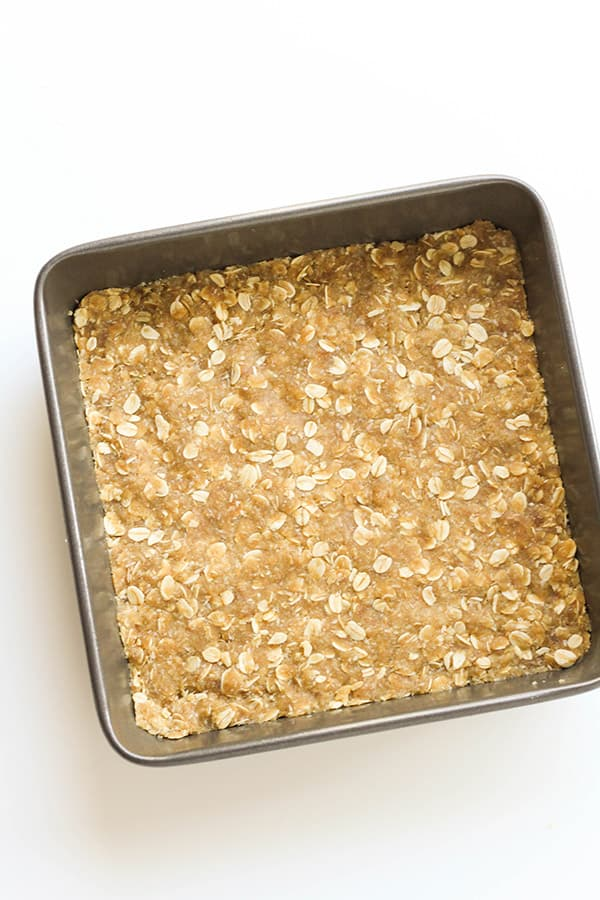 unbaked anzac slice in a slice pan.