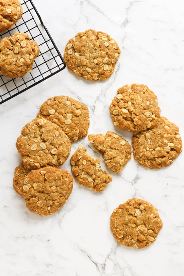 anzac biscuits scattered on a marble background.
