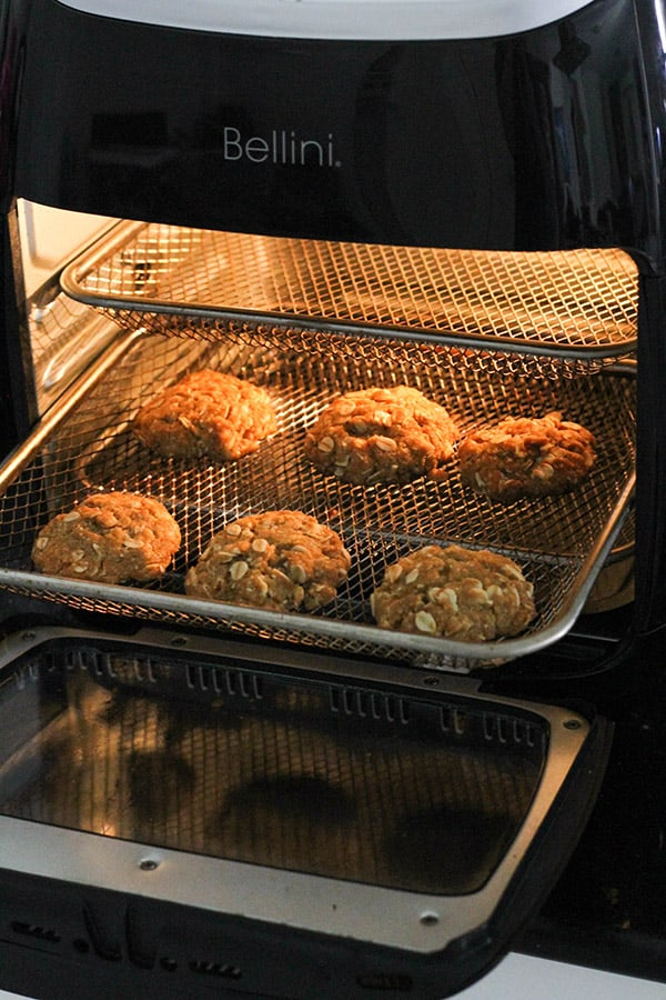 biscuits baking in an air fryer.