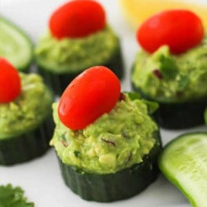 cucumber bites on a white plate.
