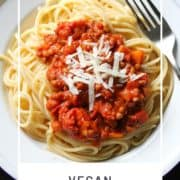 "spaghetti and sauce on a white plate with text overlay ""vegan lentil bolognese""."