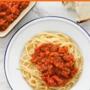 """image of finished dish with text overlay """"lentil bolognese - meatless monday favourite""""."""