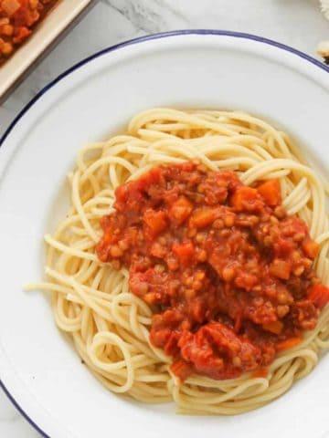 lentil bolognese on a white plate.