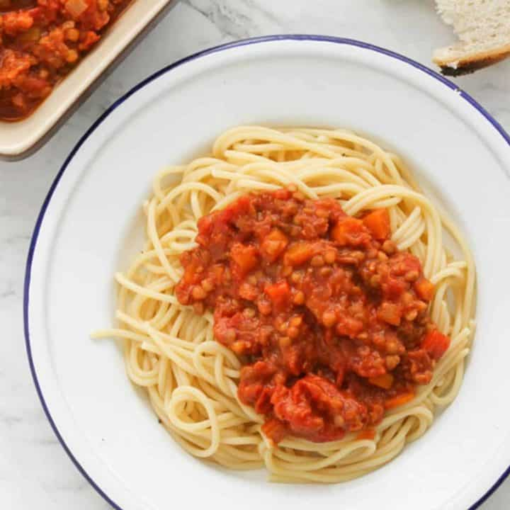 lentil bolognese on a white plate.