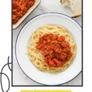 "spaghetti and sauce on a white plate with text overlay ""lentil bolognese""."
