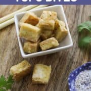 "tofu bites in a bowl with text overlay ""salt and pepper tofu bites""."