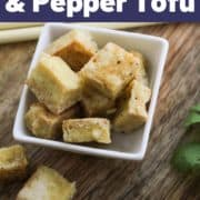 "tofu bites in a bowl with text overlay ""pan-fried salt and pepper tofu""."