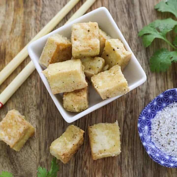 tofu bites in a square bowl.