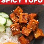 """cubes of sriracha tofu with text overlay """"pan-fried spicy tofu""""."""