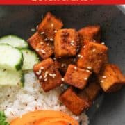 """image of finished dish with text overlay """"quick and easy sriracha tofu""""."""