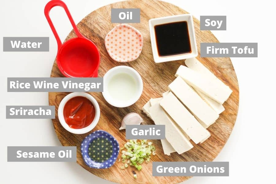 ingredients to make spicy tofu on a wooden board.