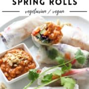 "rice paper rolls on a white plate with text overlay ""tofu + veggie spring rolls""."
