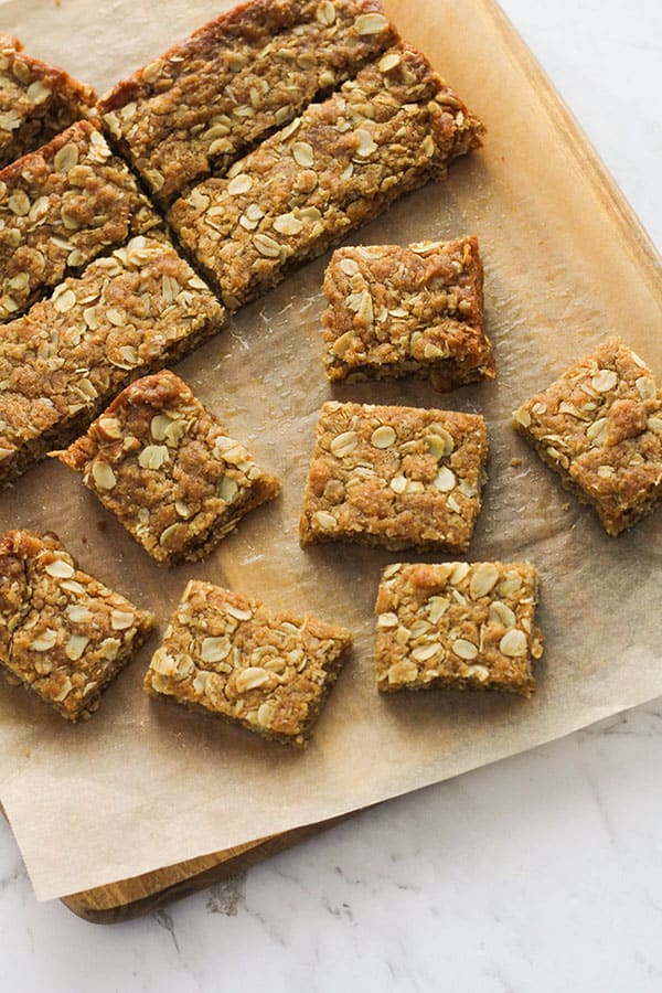 anzac slice squares on a wooden board.