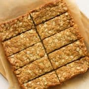 """slices on a wooden board with text overlay """"anzac slice""""."""