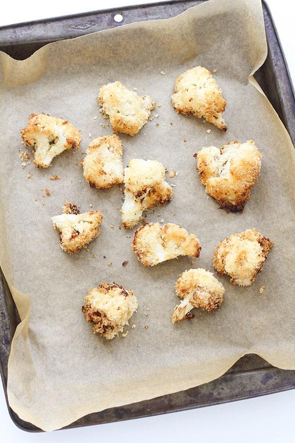 bang bang cauliflower pieces on a baking tray.