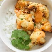 bang bang cauliflower on top of a bed of rice.