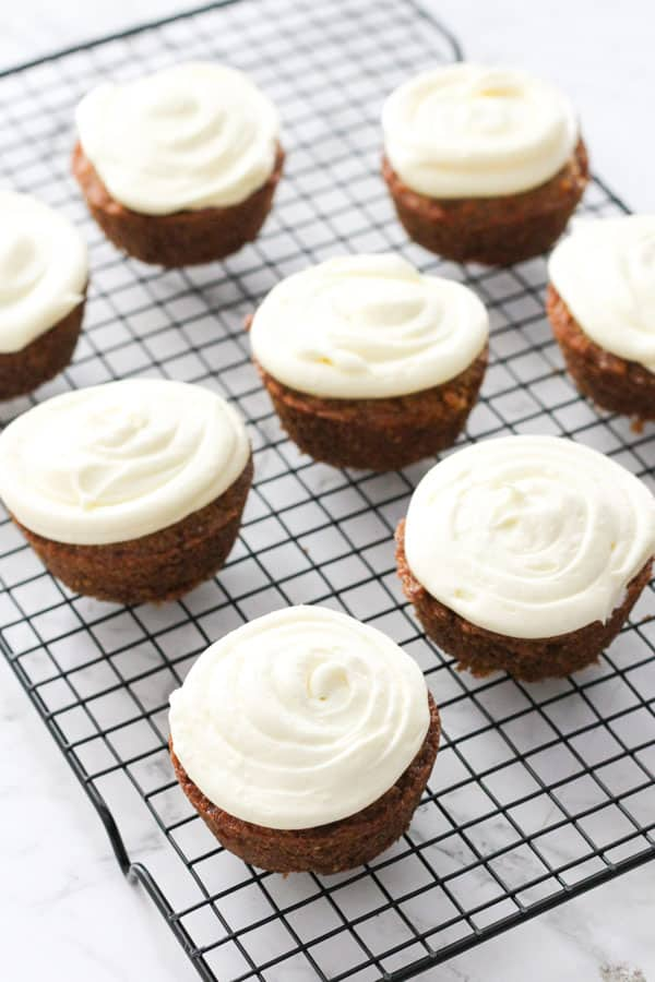 carrot cupcakes on a wire rack.