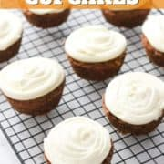 """cupcakes on a wire rack with text overlay """"carrot cake cupcakes""""."""