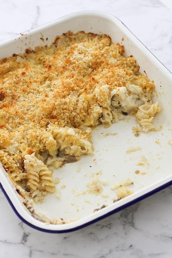 creamy vegetable pasta bake in a white baking dish.