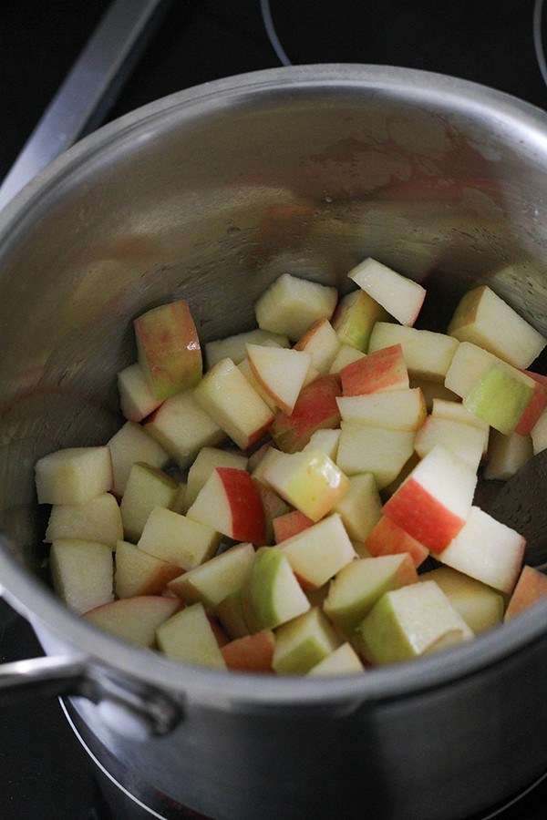 apple pieces in a saucepan.