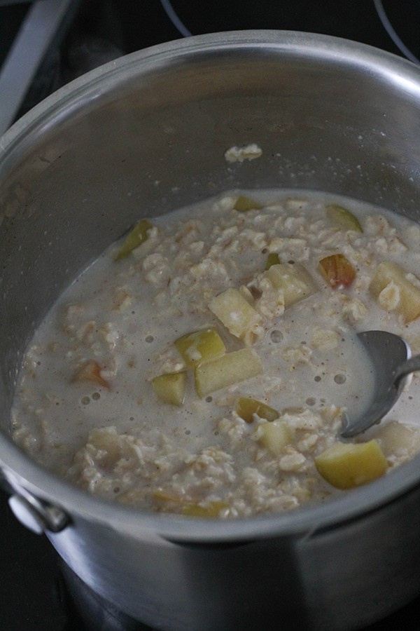 apple pieces, oatmeal and milk in a saucepan.