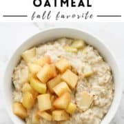 "oatmeal in a bowl with text overlay ""apple cinnamon oatmeal - fall favorite""."