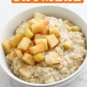 "oatmeal in a bowl with text overlay ""apple cinnamon oatmeal""."