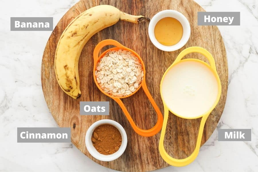 ingredients for banana porridge on top of a wooden board.