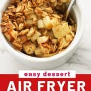 "apple crisp in a white ramekin with a spoon and text overlay ""easy dessert, air fryer apple crisp""."