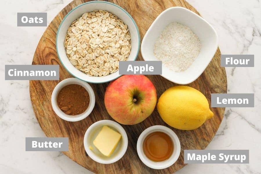 ingredients for apple crisp on a wooden board.