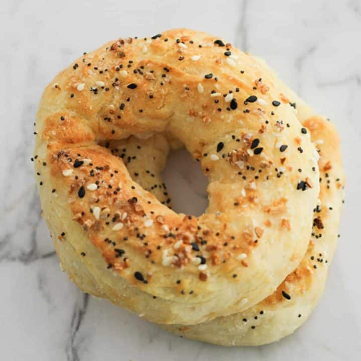 bagels stacked on top of each other on a marble board.