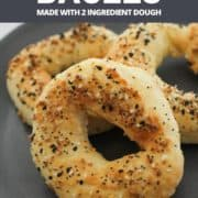 "bagels on a grey plate with text overlay ""air fryer bagels using 2 ingredient dough""."