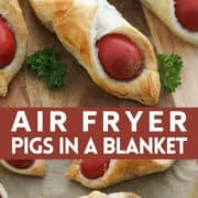 "pigs in a blanket on a wooden serving board with text overlay ""air fryer pigs in a blanket""."