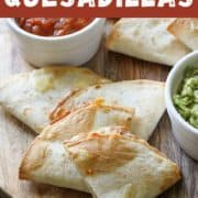 "quesadilla quarters on a wooden board with text overlay ""air fryer quesadillas""."